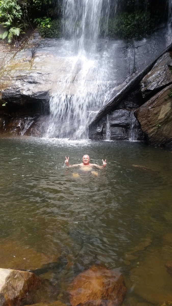 Picture of tourist enjoying swim at Bigaho Falls Port Barton Palawan