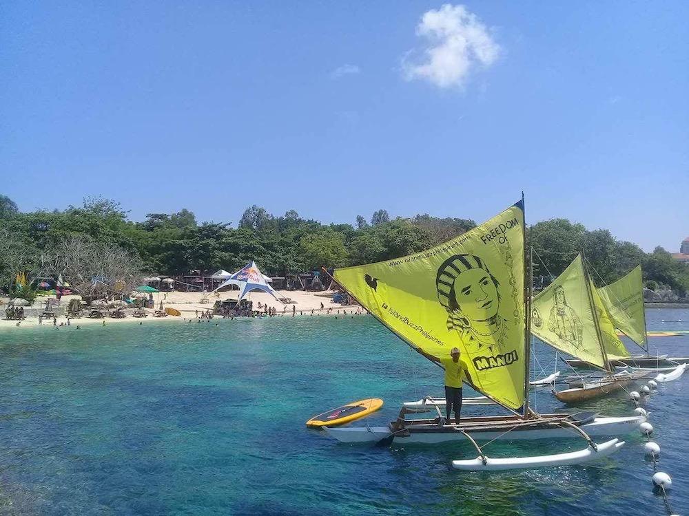 Biwig with sails on the water near Cebu