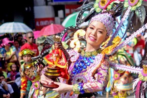 Sinulog St Nino being carried by a girl