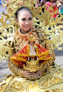 Girl with statue of St.Nino. Sinulog Festival Parade 2015.