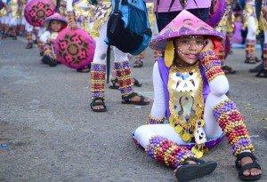 Boy resting. Sinulog Festival Parade 2015.