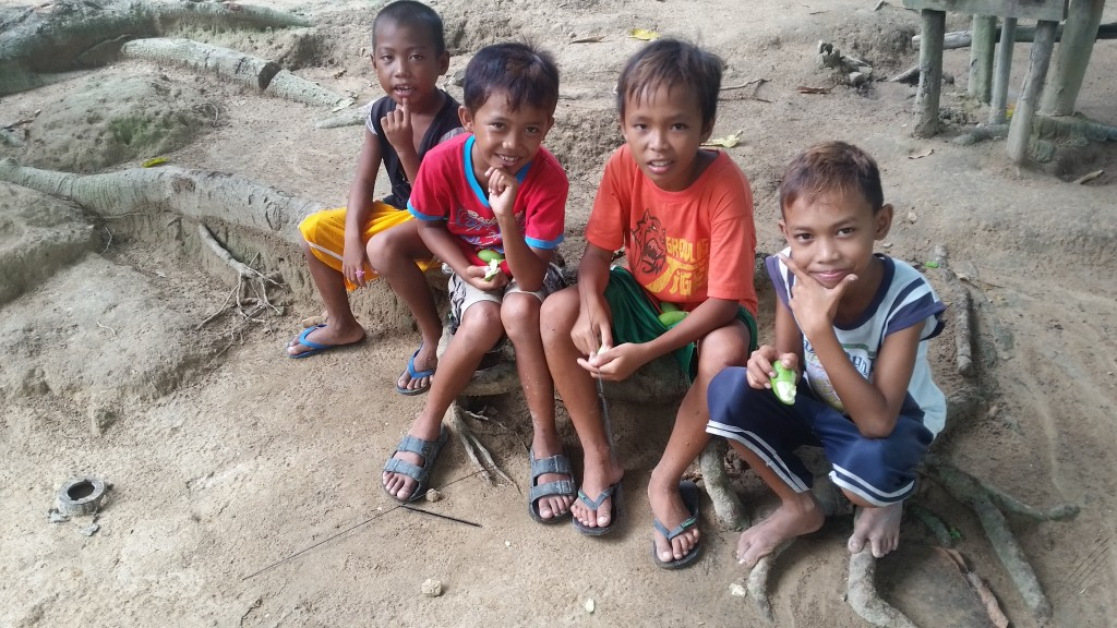 four Tagbanway children posing for a picture