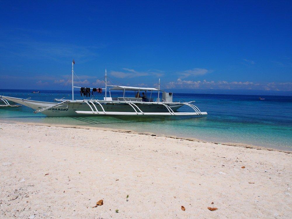 Local boat on beach of Balicasag Island, Bohol