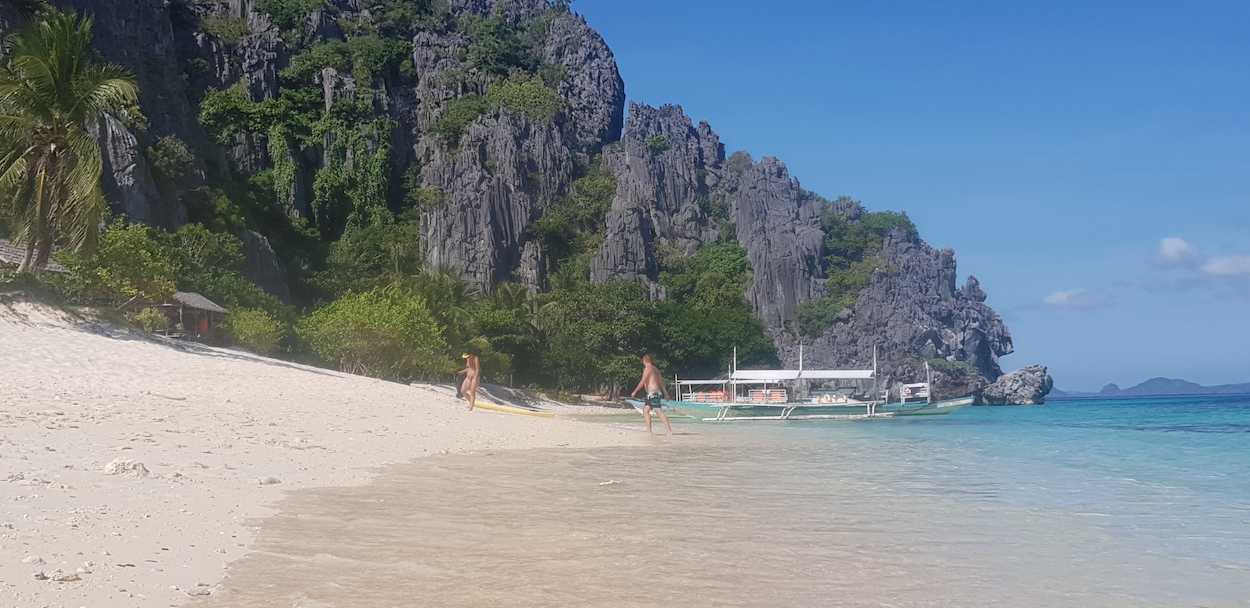 Black Island Beach Coron with boats and people