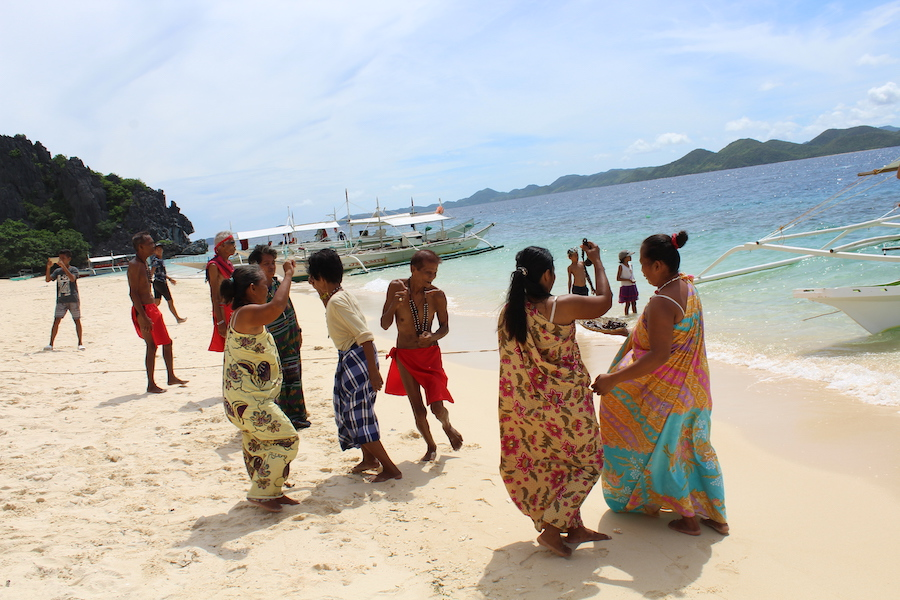 Tribal people dancing on the beach