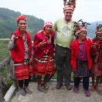 Tourist posing with Ifugao women at Banaue