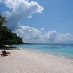Tourist sunbathing at Panglao Beach