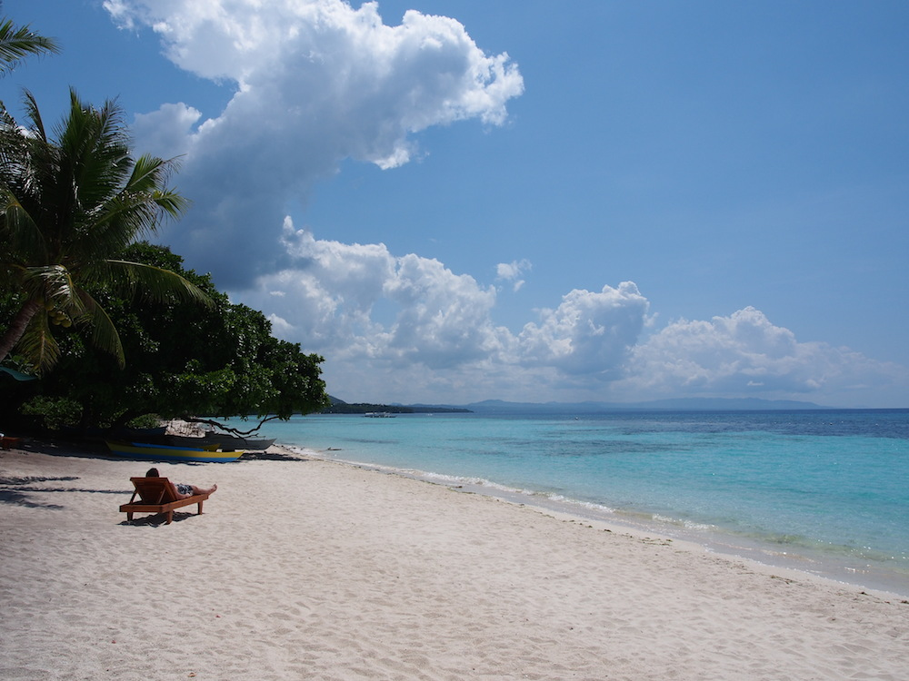 Tourist relaxing on the beach of Panglao the best of the Visayas tour