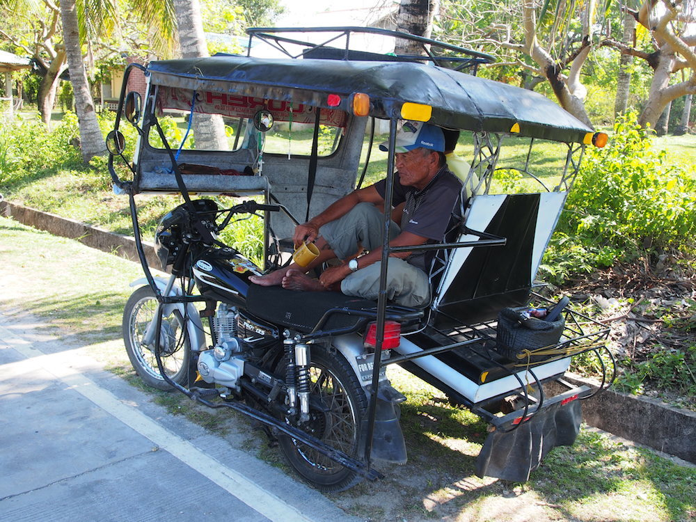 Tricycle driver resting in his tricycle on Siquijor Island