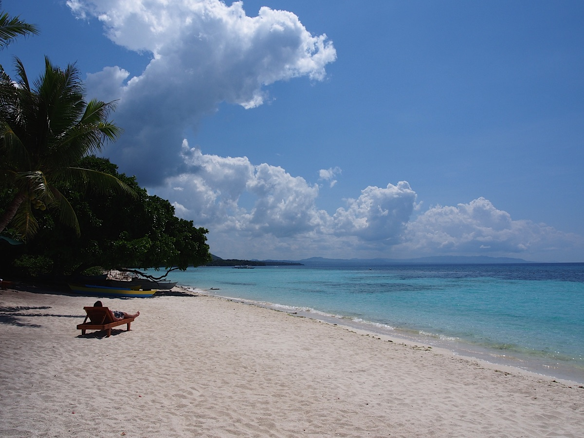 Tourtist sunbathing on Panglao Beach