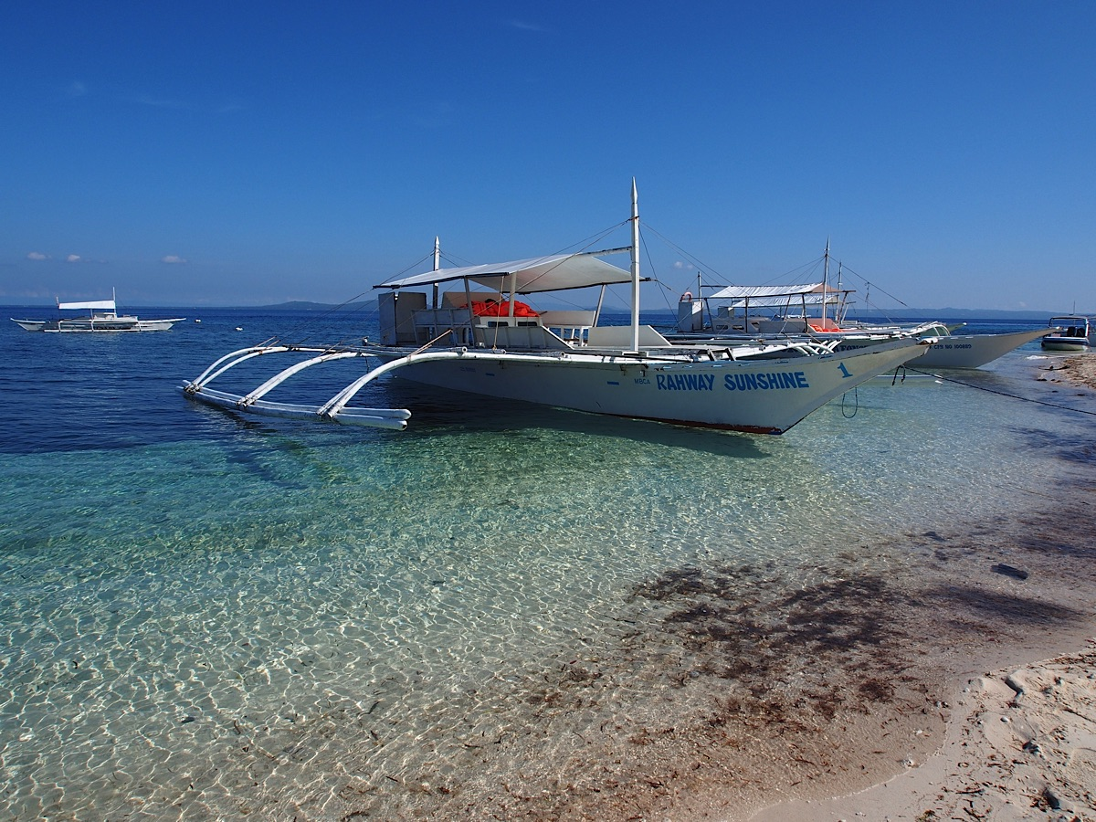 Three pumpboats on beach Bohol