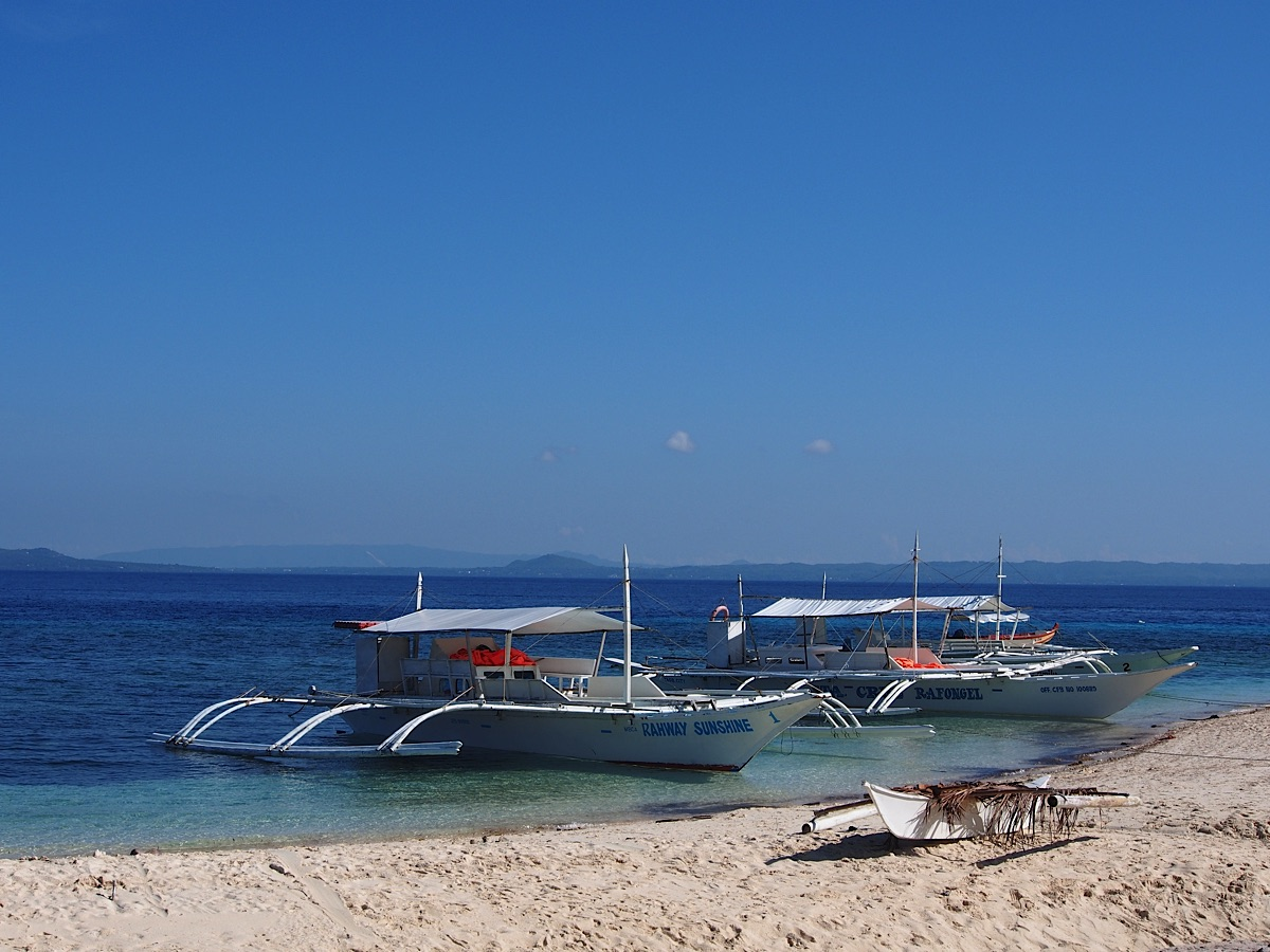Two pumpboats on beach Bohol