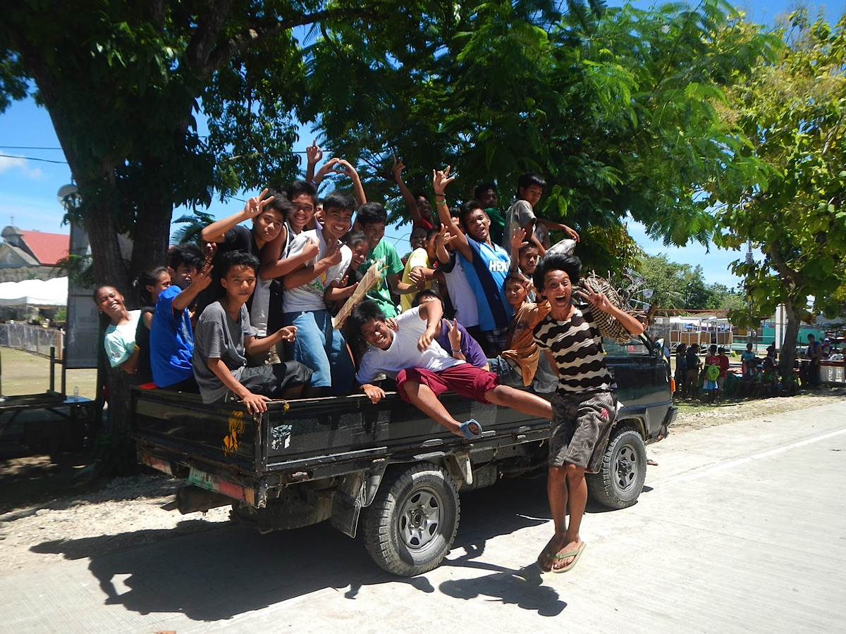 Local people in the back of vehicle Bohol Tours
