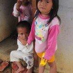Children in door opening near Osmeña Peak