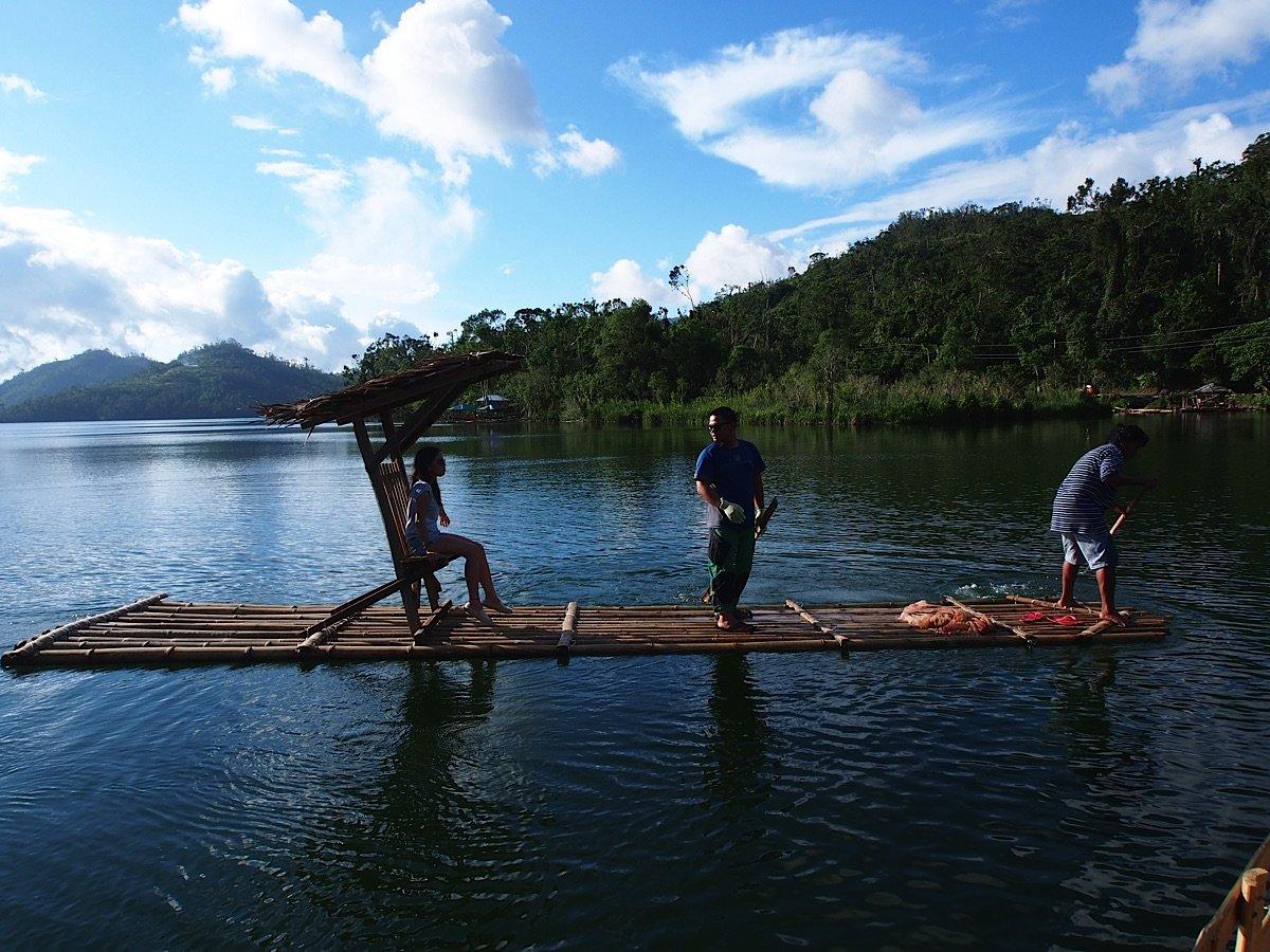 Raft with three people on Lake Danao Leyte