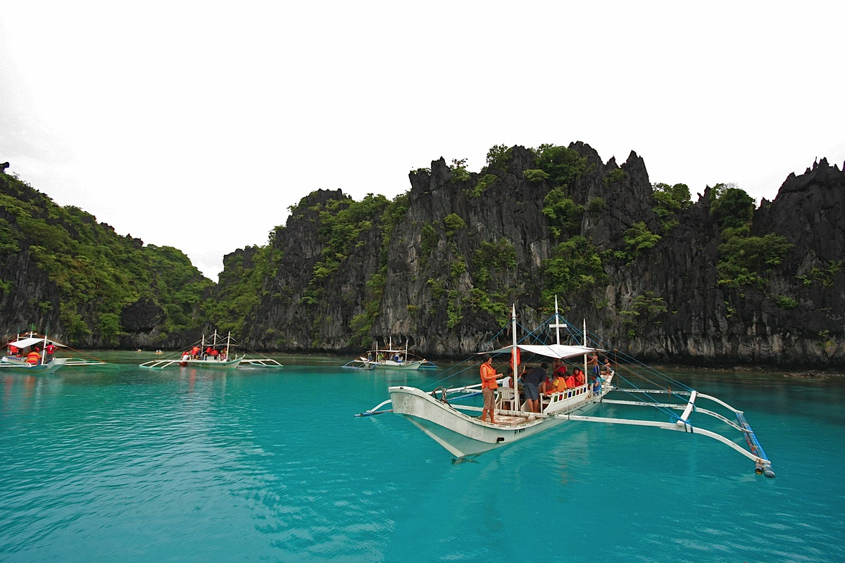 Bancas in a lagoon Palawan tours