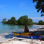 Man with local boat on beach Siquijor